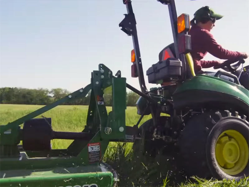 Frontier Rotary Cutter being pulled by John Deere Tractor