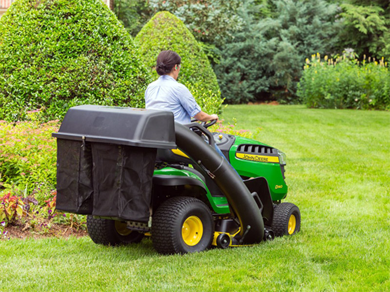 Man Cutting Grass with John Deere D140 Lawn Tractor
