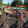 Kubota L47 Tractor Loader Backhoe moving dirt