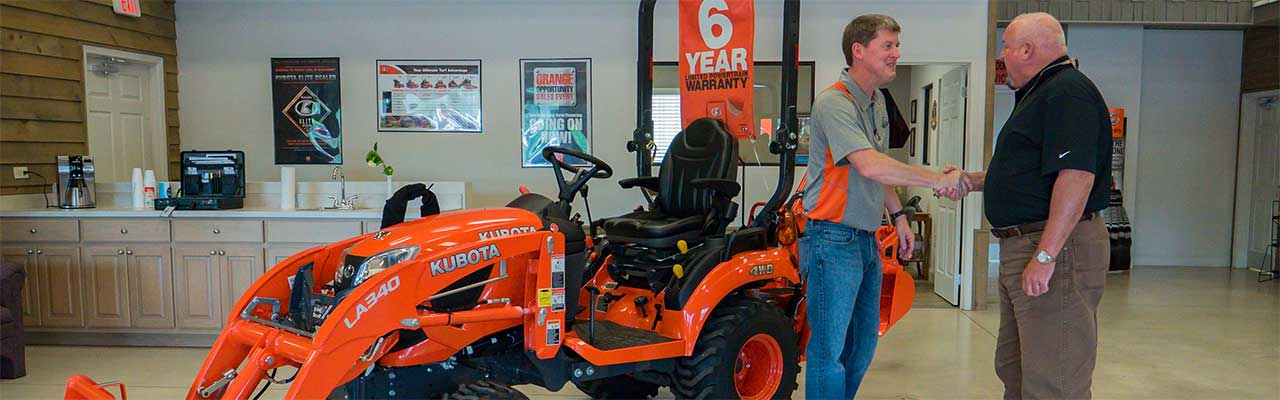 Kubota Dealer, Nelson Tractor Salesman and Customer shaking hands